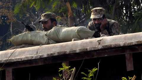Pakistani soldiers hold positions close to the school. All the militants in the attack were eventually killed, a police official said.