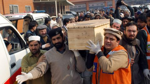 Caption:Pakistani volunteers move the coffin of a student from a hospital following an attack by Taliban gunmen on a school in Peshawar on December 16, 2014. Taliban insurgents killed at least 130 people, most of them children, after storming an army-run school in Pakistan December 16 in one of the country's bloodiest attacks in recent years. AFP PHOTO/ A MAJEED (Photo credit should read A Majeed/AFP/Getty Images)