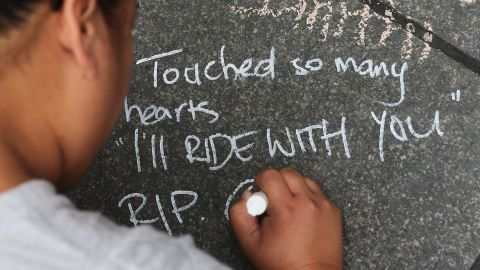 A message of condolence messages is written on the pavement at Martin Place on December 17. #illridewithyou became a trending hashtag on Twitter during the siege, expressing solidarity with Australian Muslims in the wake of the incident.