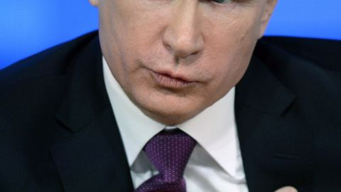 Russian President Vladimir Putin speaks during his annual press conference in Moscow on December 18, 2014.