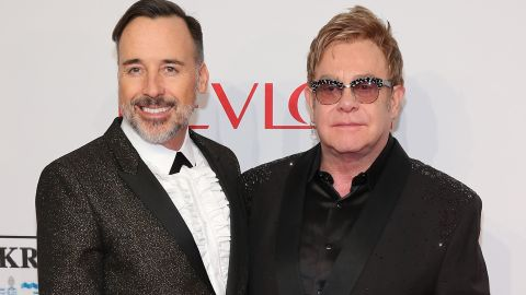 """<a href=""""http://www.cnn.com/2014/12/21/showbiz/elton-john-wedding/index.html"""" target=""""_blank"""">David Furnish, left, and Sir Elton John married</a> in December 2014 in Britain. They had a civil partnership ceremony in 2005 after 12 years together."""