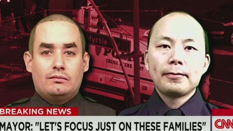 ac dnt kaye slain nypd officers liu ramos profiles _00000905.jpg