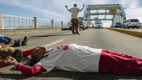 """Longtime activist Faya Rose Toure leads a """"die-in"""" on the Edmund Pettus Bridge, a prominent landmark in Selma, Alabama. Police attacked civil rights marchers on the bridge 50 years ago at a protest that became known as """"Bloody Sunday."""" Toure evokes Selma's past in her attempts to change the present."""