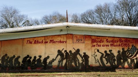 """A mural on a building at the foot of the Edmund Pettus Bridge commemorates Bloody Sunday. Some scenes for the movie """"Selma"""" were filmed near this building."""