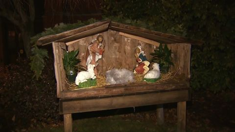 A pig's head wrapped in plastic was left in the center of the manger in the church's nativity scene.