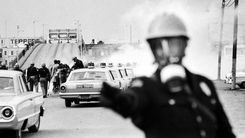 About 600 people began a 50-mile march from Selma to the Alabama state capitol in Montgomery on March 7, 1965. They intended to protest discriminatory practices that prevented black people from voting. But as the marchers descended to the foot of the Edmund Pettus Bridge, state troopers used brutal force and tear gas to push them back.