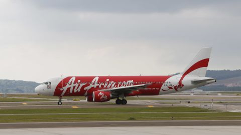 CORRECTS NUMBERS OF PASSENGERS ON BOARD - In this Nov. 26, 2014 photo, AirAsia Airbus A320-200 passenger jets are taxing on the tarmac at low cost terminal KLIA2 in Sepang, Malaysia. An AirAsia plane with 162 people on board lost contact with ground control on Sunday, Dec. 28, 2014, while flying over the Java Sea after taking off from a provincial city in Indonesia for Singapore, and search and rescue operations were underway. The plane in this photo is not the plane that went missing while flying from Indonesia to Singapore but one of the same models.  (AP Photo/Vincent Thian/AP)
