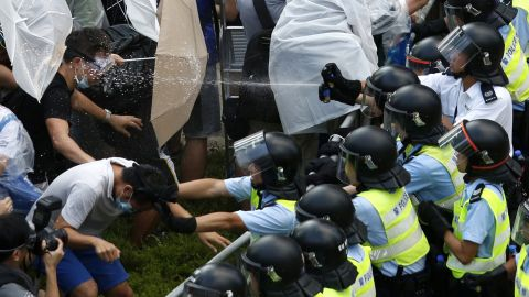 """Riot police use pepper spray as they clash with pro-democracy protesters outside the government headquarters in Hong Kong on September 28, 2014. <a href=""""http://www.cnn.com/2014/09/22/asia/gallery/hong-kong-students-protest/index.html"""">Demonstrations began</a> in response to China's decision to allow only Beijing-vetted candidates to stand in the city's 2017 election for chief executive. Protesters say Beijing has gone back on its pledge to allow universal suffrage in Hong Kong, which was promised """"a high degree of autonomy"""" when it was handed back to China by Britain in 1997. The umbrella has become the defining image of the protest movement, used to shield protesters from tear gas and the elements."""