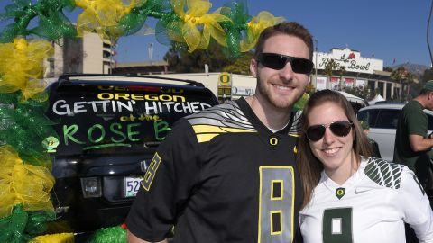 Oregon fans Steve Twomey and Lisa DeFluri pose for a photo at the Rose Bowl.