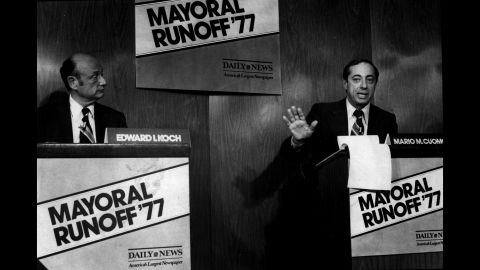 Democratic mayoral candidates Ed Koch, left, and Cuomo take part in a debate at the New York Daily News.
