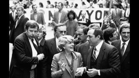 Democratic vice presidential candidate Geraldine Ferraro and New York Gov. Mario Cuomo march in New York's Columbus Day parade on October 9, 1984.