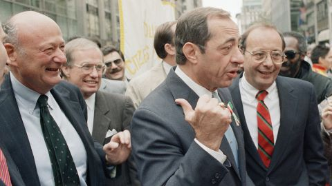 New York's Mayor Ed Koch, left; behind him, New York's Lt. Gov. Stanley Lundine; Cuomo, center; and Sen. Alfonse D'Amato, right, share a laugh at the Columbus Day Parade along New York's Fifth Avenue on October 12, 1987.