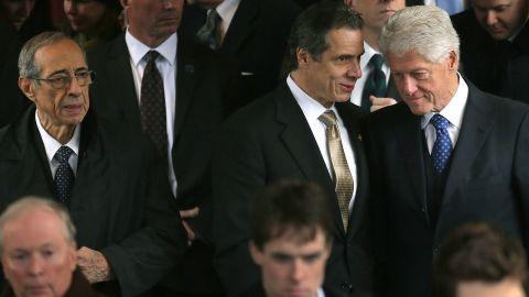 Former New York Gov. Mario Cuomo is far left, followed by New York Gov. Andrew Cuomo and former President Bill Clinton in 2013.