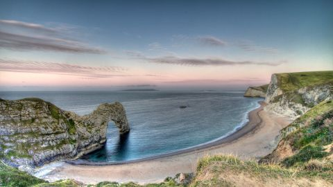 Featuring 240-million-year-old rocks, the South West Coast Path's prehistoric UK cliffs feature spectacular formations like Durdle Door and Ladram Bay.