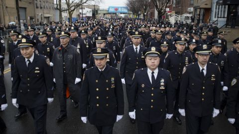 Police officers from across the country arrive at the funeral.