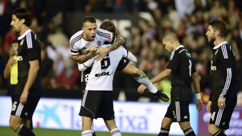 Valencia's Nicolas Otamendi celebrates after scoring against Real Madrid.