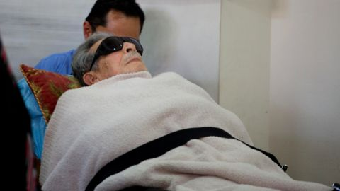 Former Guatemalan dictator Efrain Rios Montt arrives on a gurney to court in Guatemala City, where he faces charges of genocide and crimes against humanity on Monday, January 5.