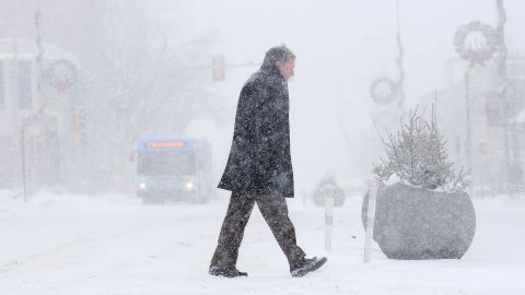 Bill Taylor walks from the YMCA to his office on Monday in Sioux Falls, South Dakota.