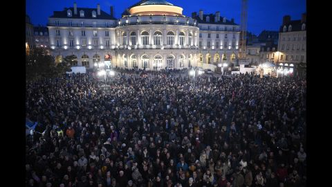 People gather in front of city hall in Rennes on January 7.
