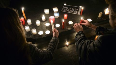 People light candles during a vigil in Geneva, Switzerland, on January 7.