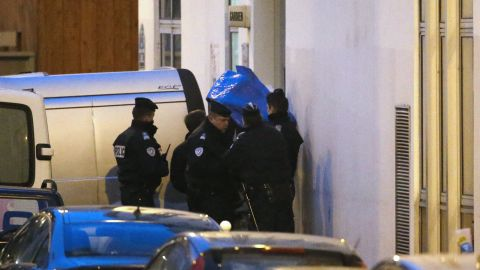 Police carry a body from the scene of the shooting.