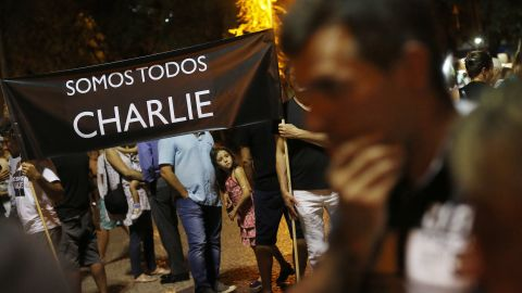 """People in Rio de Janeiro hold a sign that reads """"We're all Charlie"""" on January 7."""