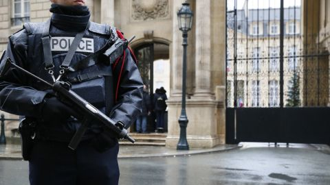 A police officer stands guard in front of Paris' Elysee Palace on January 8.