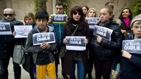 French journalists and their families show solidarity with the Paris victims outside the French Embassy in New Delhi on January 8.