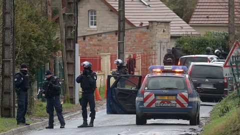 French police patrol a street in Corcy on January 8.