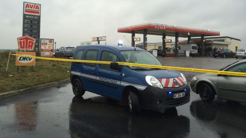On January 8, police tape and vehicles block off the entrance to a gas station north of Paris where the two suspects were reportedly seen the night before.