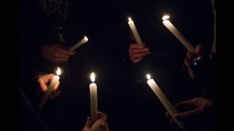 People hold candles during a gathering at Place de la Republique, a square in Paris, on January 7.