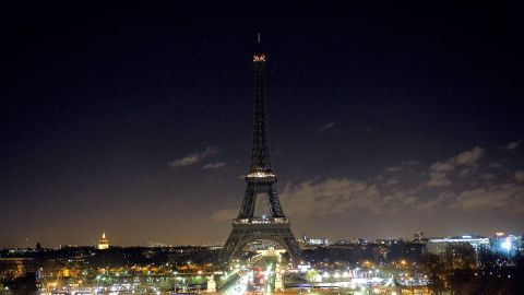In remembrance of the victims, the Eiffel Tower goes dark on January 8.