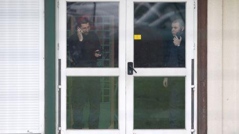 Police officers communicate inside a school in Dammartin-en-Goele.