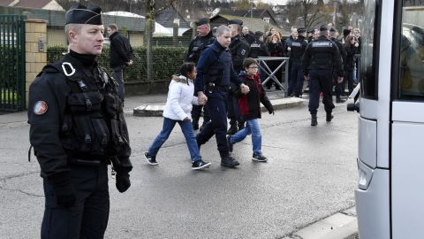 French gendarmes stand by as children are evacuted from a school in Dammartin-en-Goele. DOMINIQUE FAGET/AFP/Getty Images)