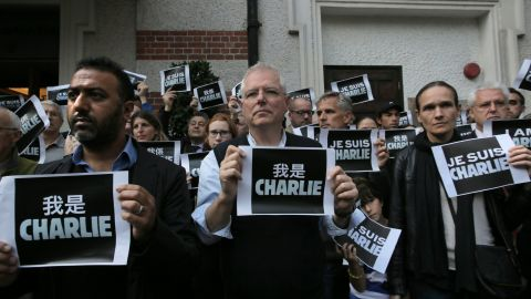 """Journalists and supporters of press freedom hold placards saying """"I am Charlie"""" outside the Foreign Correspondents' Club in Hong Kong on January 8."""