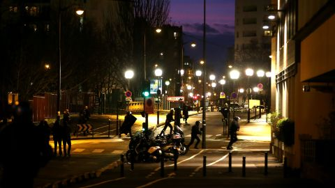 """Police mobilize at the scene in Paris. One of the hostages told CNN affiliate BFMTV that the gunman started shooting """"as soon as he got inside"""" and killed two customers."""