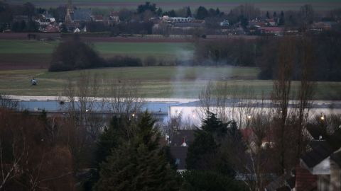 Smoke rises from the building in Dammartin-en-Goele, a town about 40 kilometers (25 miles) northeast of Paris.