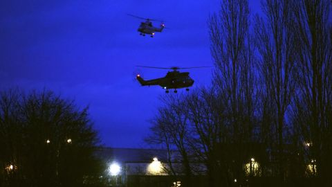 """Helicopters fly over a printing shop in Dammartin-en-Goele, France, where there was a standoff Friday, January 9, between police and two men suspected in <a href=""""http://www.cnn.com/2015/01/07/world/gallery/paris-charlie-hebdo-shooting/index.html"""" target=""""_blank"""">the Charlie Hebdo shootings</a> earlier this week. Cherif and Said Kouachi, the two brothers wanted in the case, were killed by security forces, authorities said."""