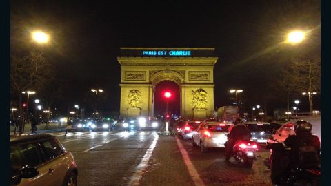"The city of Paris tweeted this image showing the Arc de Triomphe with ""Paris est Charlie"" (Paris is Charlie) in lights."