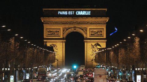 """Lights on the Arc de Triomphe say """"Paris est Charlie"""" (Paris is Charlie) on January 9."""