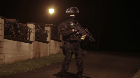 A police officer stands guard in Fleury, France, on Thursday, January 8.