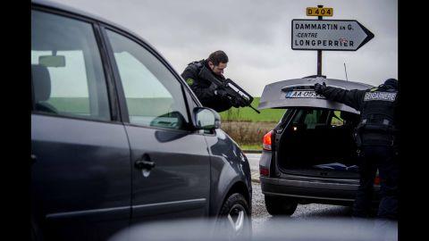 A police officer checks a car in Dammartin-en-Goele.