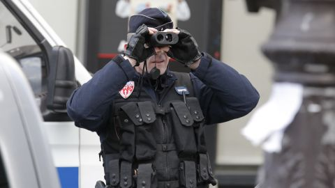 A police officer keeps watch before the rally.