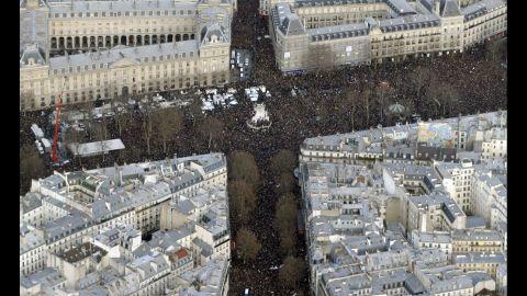The massive crowd at the Place de la Republique is seen from above.