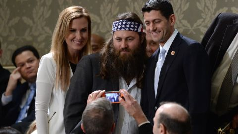 """Willie Robertson of the reality TV series """"Duck Dynasty"""" poses for a picture with Ryan and his wife, Janna, before President Obama delivers his State of the Union address on January 28, 2014."""