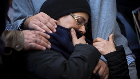 """The mother of Hattab is comforted during his funeral procession. <a href=""""http://cnn.com/2015/01/10/world/france-paris-who-were-terror-victims/"""">He was the son of the chief rabbi of Tunis</a>, Tunisia, JSSNews reported. Hattab will be buried in Jerusalem with the other victims."""