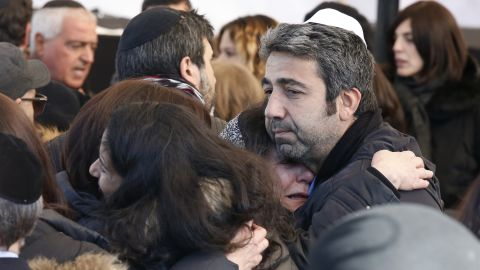 Israeli mourners hug at the funeral in Jerusalem of four French Jews killed in an attack on a kosher supermarket in Paris last week.