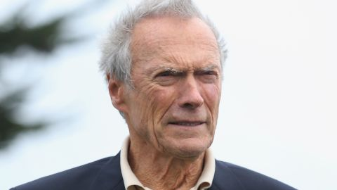 PEBBLE BEACH, CA - FEBRUARY 09: Clint Eastwood stands on the 18th green during the final round of the AT&T Pebble Beach National Pro-Am at the Pebble Beach Golf Links on February 9, 2014 in Pebble Beach, California. (Photo by Christian Petersen/Getty Images)
