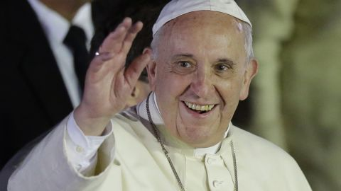 Pope Francis waves to well-wishers upon arrival from Sri Lanka, Thursday, Jan. 15, 2015 at suburban Pasay city, south of Manila, Philippines. Ecstatic crowds greeted the pontiff as he arrived Thursday in the Philippines, Asia's most populous Catholic nation, for the first papal visit in 20 years. (AP Photo/Bullit Marquez)