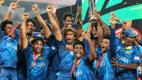 The shortened form of cricket that encourages batters to hit big has drawn large crowds. Here Lasith Malinga of Sri Lanka and his team celebrate winning the 2014 World Cup trophy in Dhaka, Bangladesh.